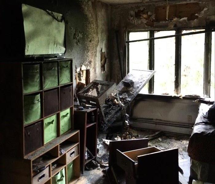 Fire damaged bookshelves and miscellaneous furniture