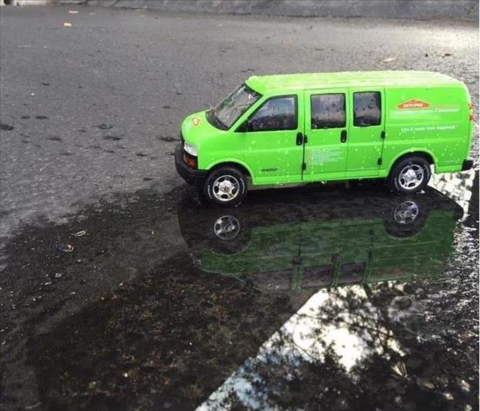 SERVPRO van in a flooded parking lot