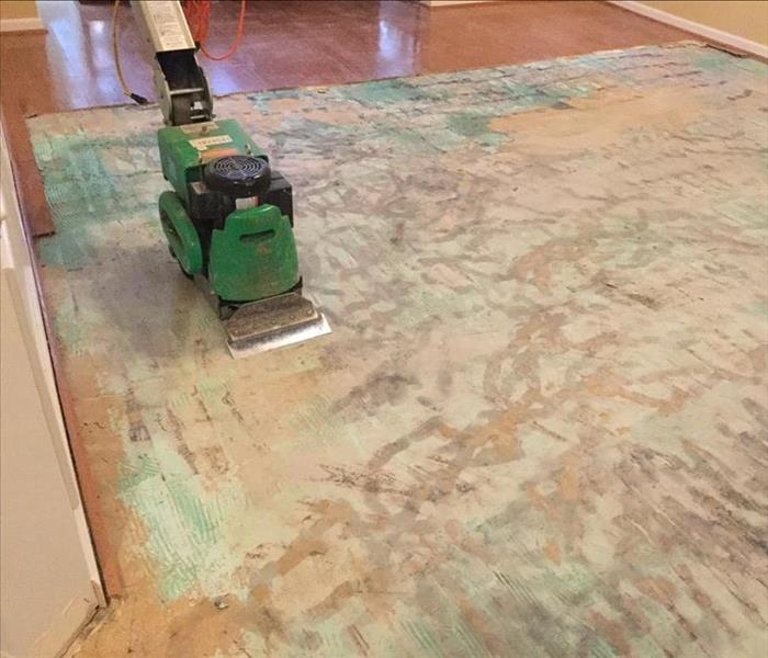 Removed hardwood flooring using a floor scraper