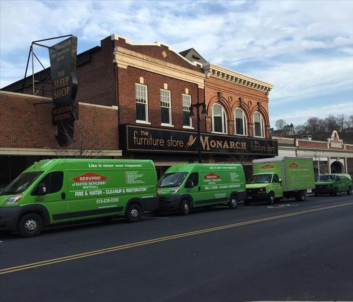 SERVPRO fleet in front of a center city furniture store