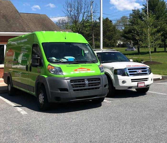 SERVPRO van outside structure.