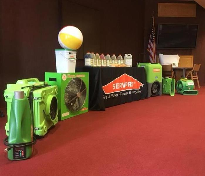 SERVPRO equipment lined up along the front of a continuing education classroom