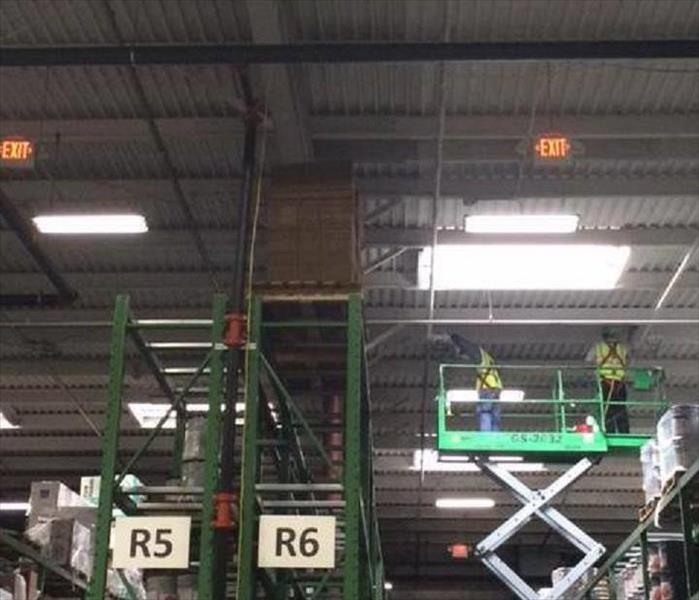 Scissor lift in a warehouse