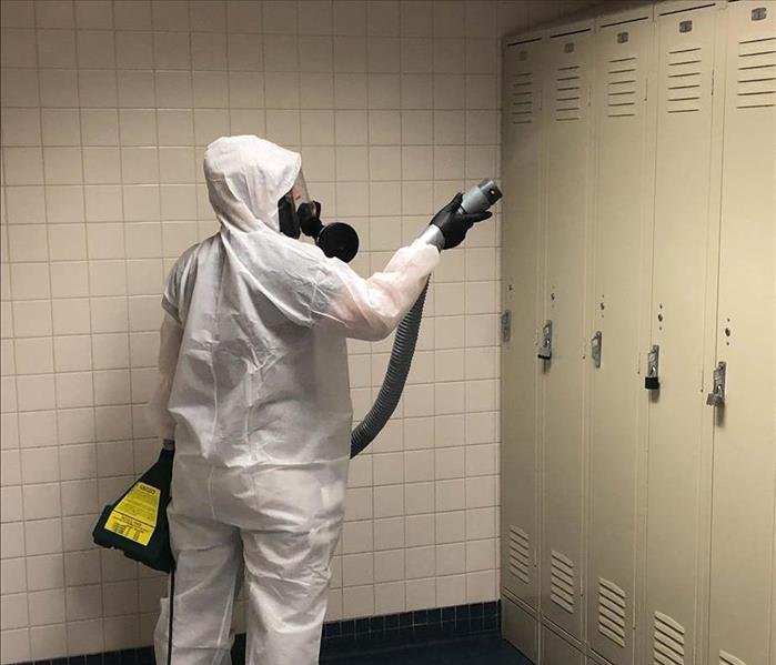 Team member fogging during a commercial disinfection.
