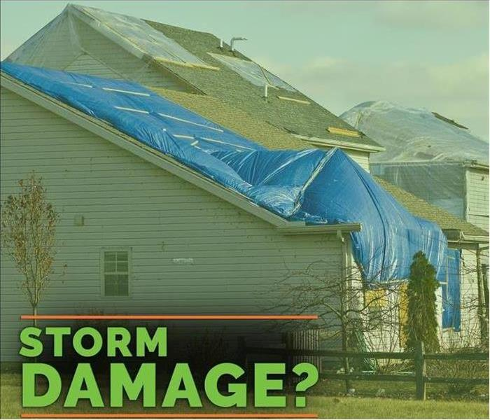 SERVPRO Storm Damage? Tarped roof after storm damage