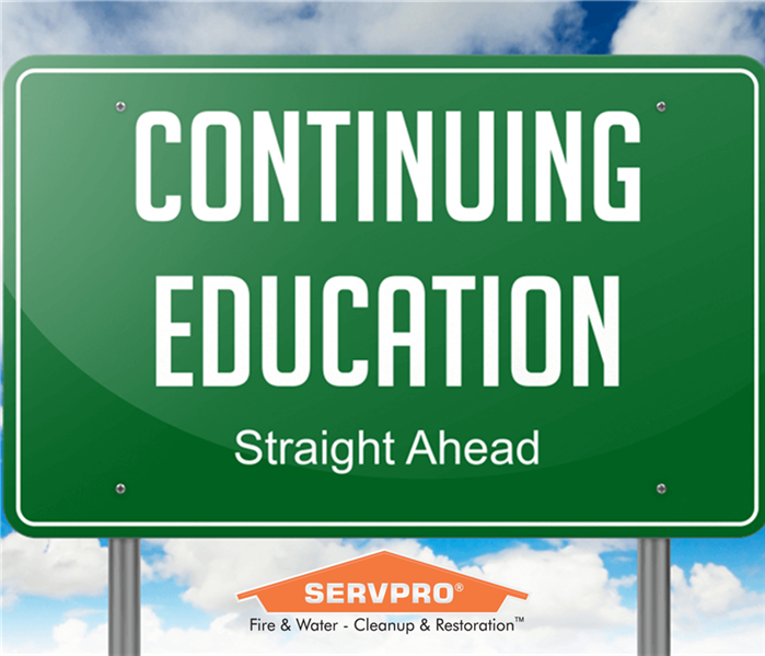 """Continuing Education"" road sign with SERVPRO logo"