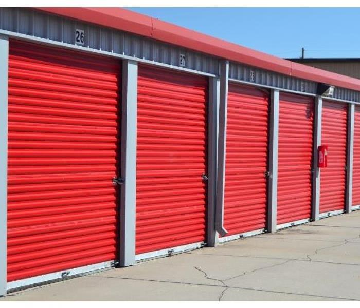 A row of 5 red storage container bay doors