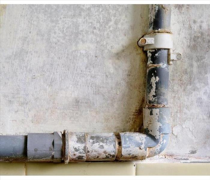 Water piping tube installed externally along the bathroom wall to supply water for a heater