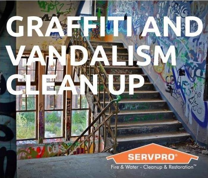 Graffiti and Vandalism Clean Up SERVPRO - graffiti covered stairs in the background