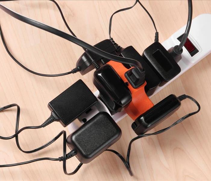 Power strip overloaded with electrical plugs