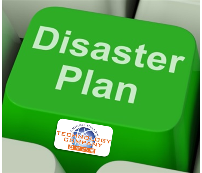 "Green computer key with the words ""Disaster Plan"" across the top"