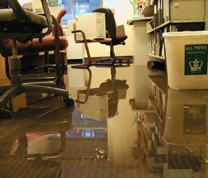 Office chairs in water-damaged office - puddling water
